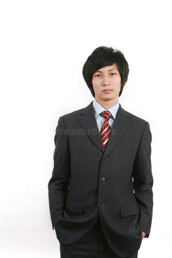 Homem de negócio que está com fundo branco imagens de stock royalty free