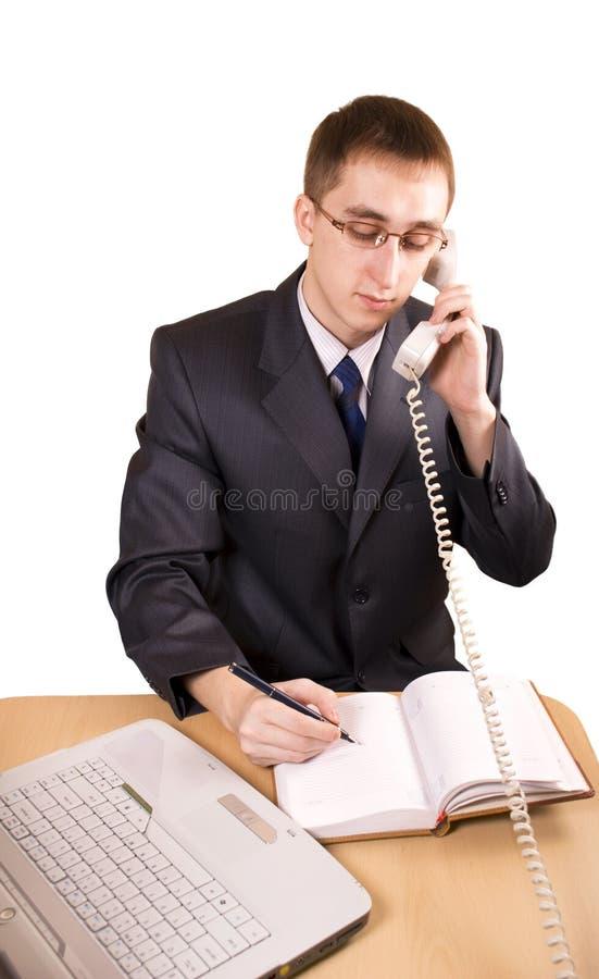 Homem de negócio que fala em um telefone foto de stock royalty free