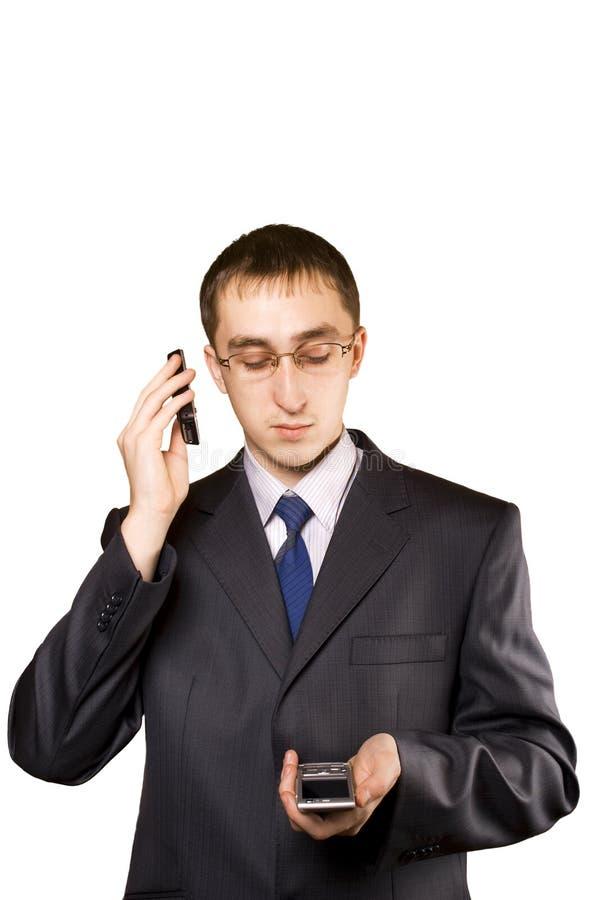 Homem de negócio que fala em um telemóvel imagens de stock royalty free