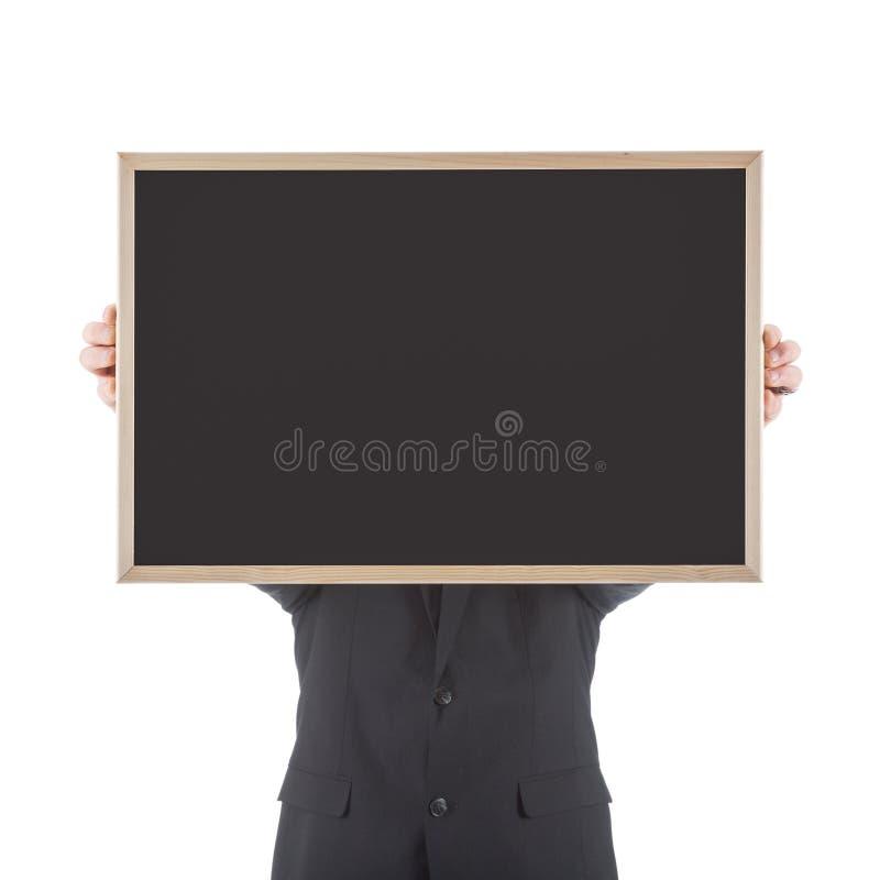Homem de negócio que guarda o quadro vazio antes de sua cabeça foto de stock royalty free