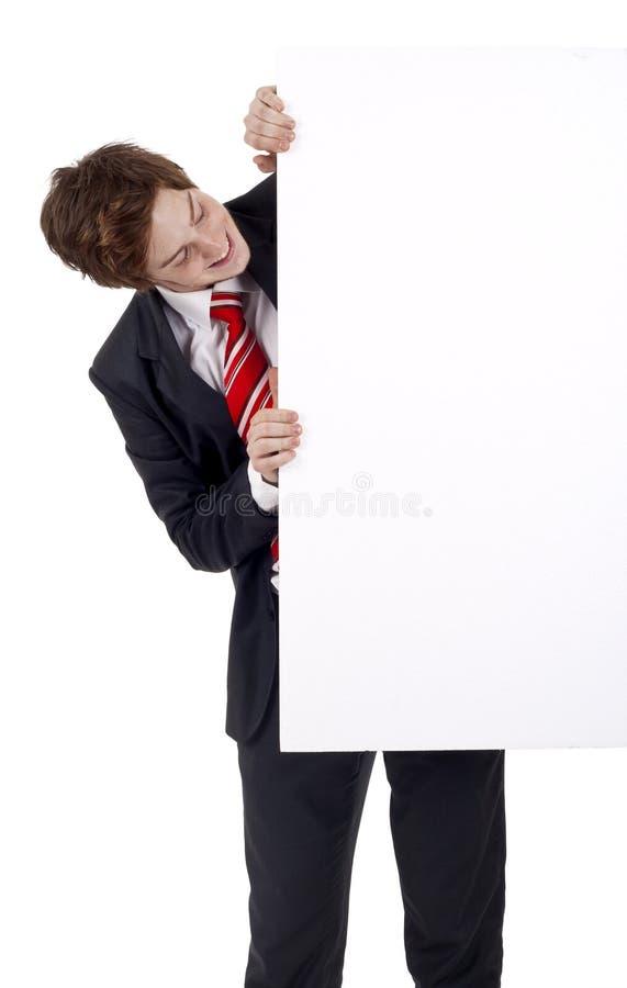 Homem de negócio que indica uma bandeira fotografia de stock