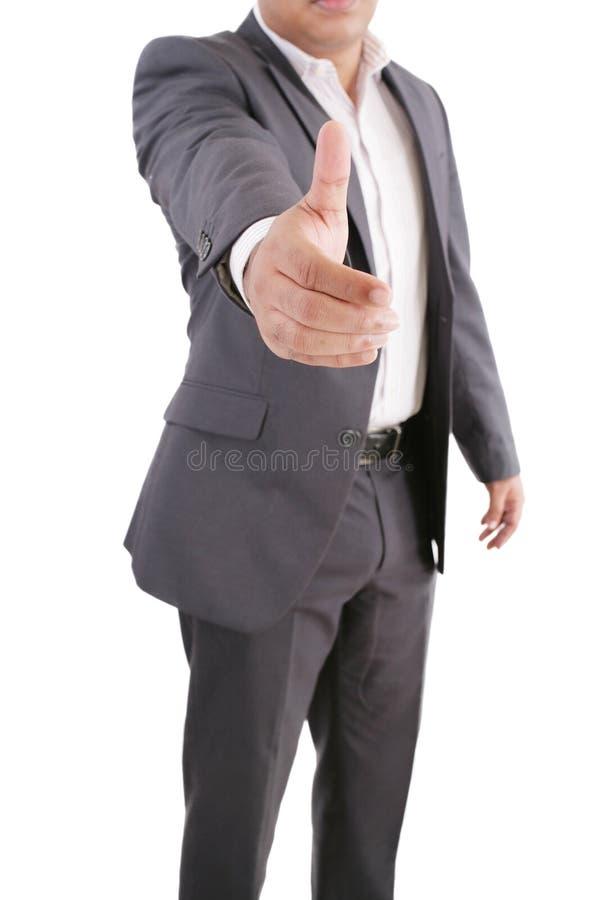 Homem de negócio que oferece um aperto de mão imagens de stock royalty free