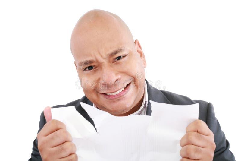 Homem de negócio que olha irritado fotografia de stock