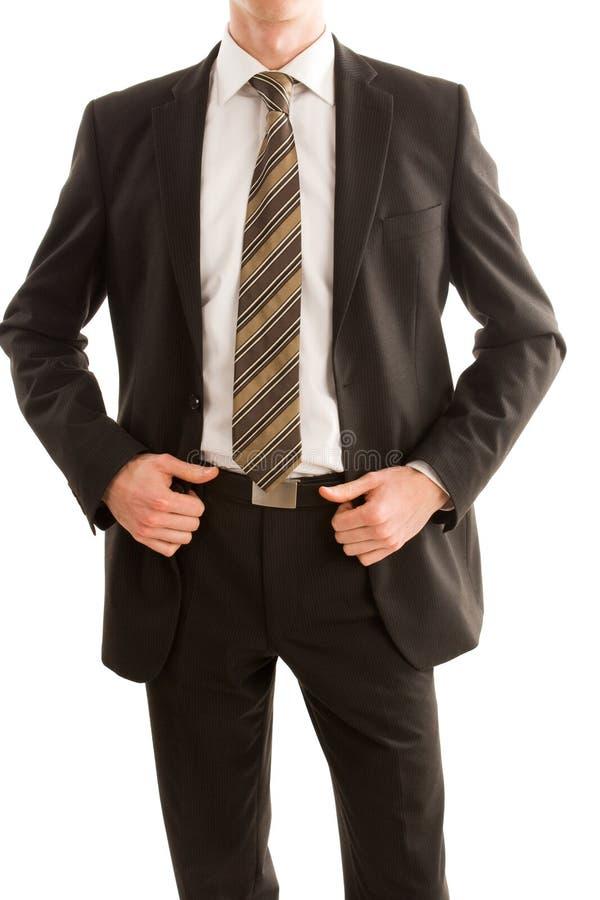Homem de negócio que prende seu revestimento do terno fotos de stock royalty free