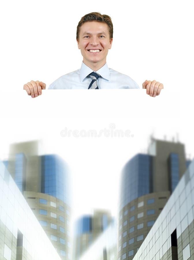 Homem de negócio que prende uma placa branca com corporativo foto de stock royalty free