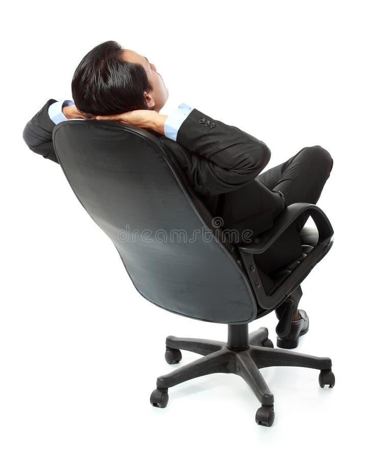 Homem de negócio que relaxa fotografia de stock royalty free