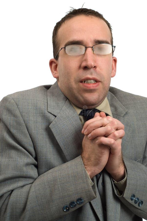 Homem de negócio que tirita imagens de stock royalty free