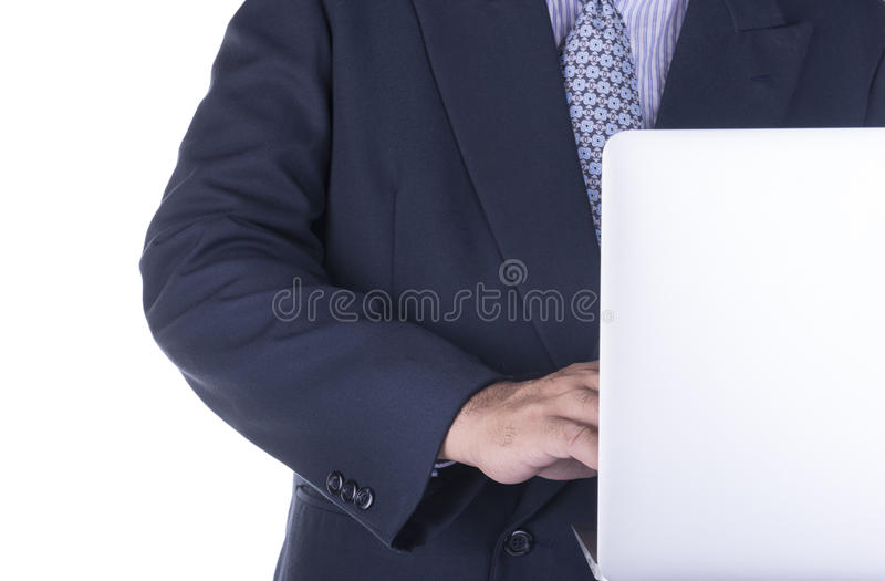Homem de negócio que usa um computador no trabalho imagem de stock