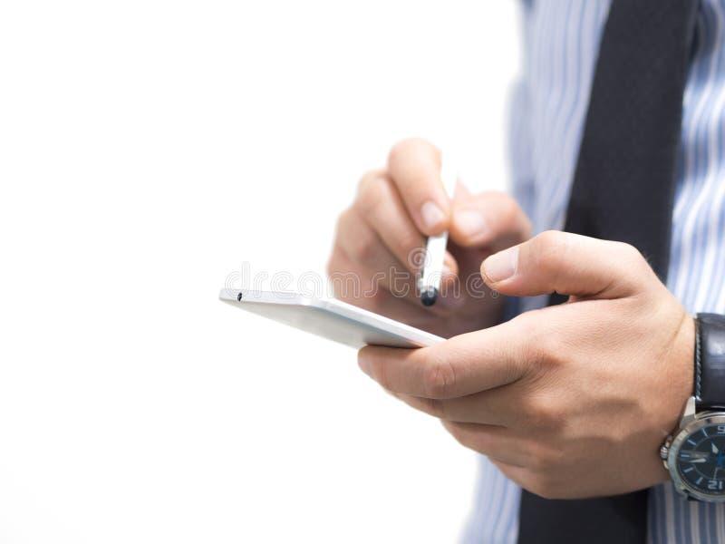 Homem de negócio que usa um smartphone imagens de stock royalty free