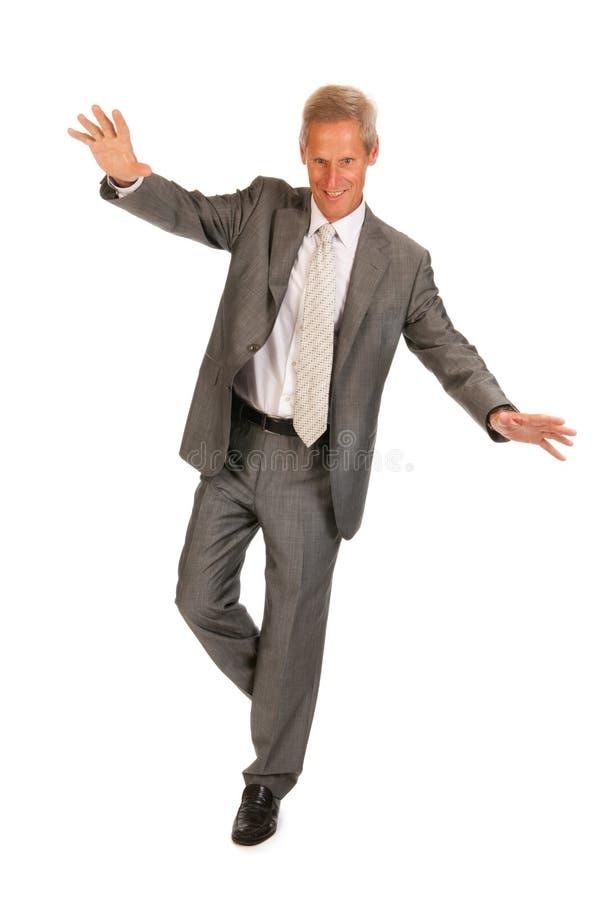 Homem de negócio sênior de equilíbrio fotografia de stock royalty free