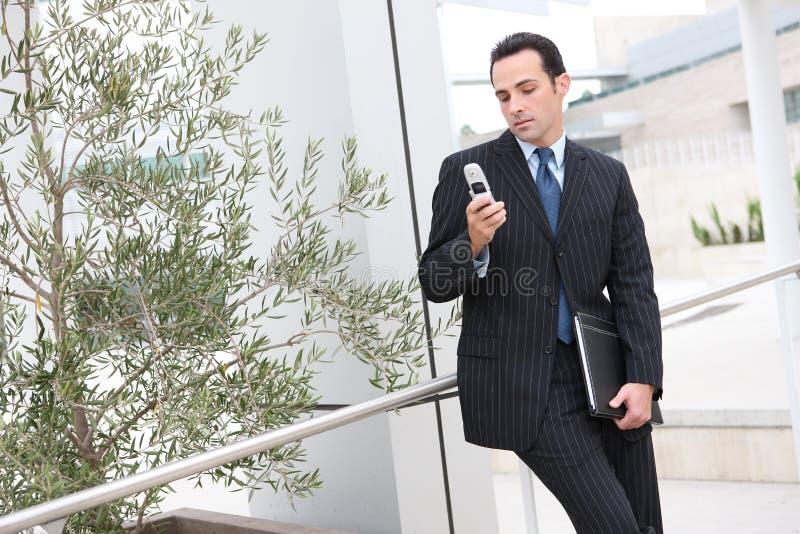Homem de negócio Texting imagem de stock