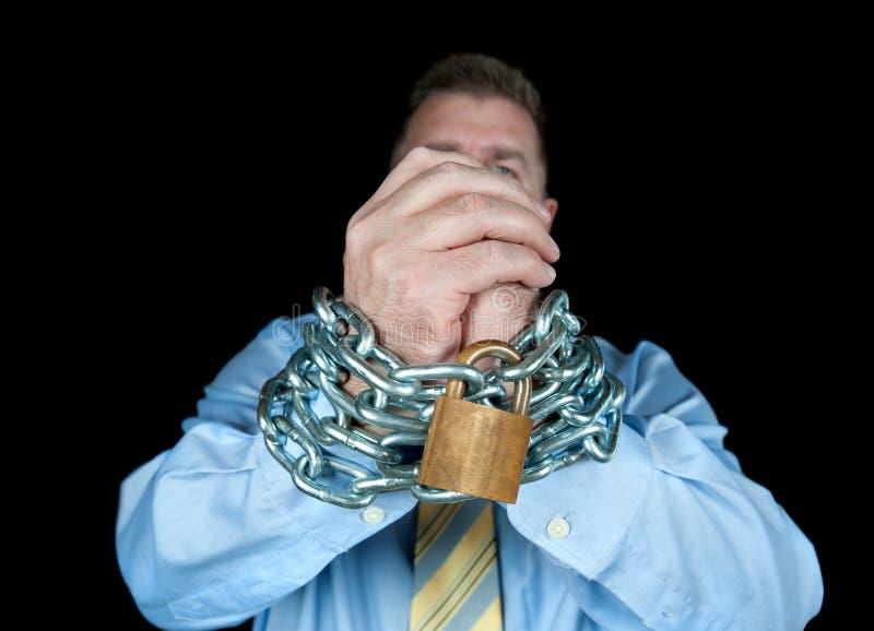Homem de negócios acorrentado fotografia de stock royalty free