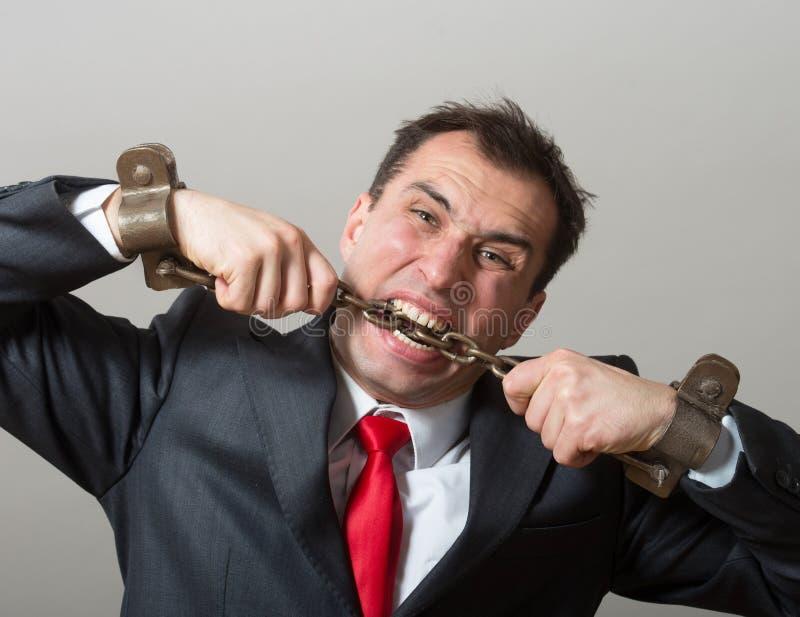Homem de negócios acorrentado imagem de stock
