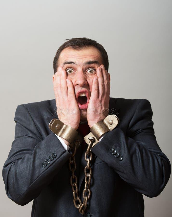 Homem de negócios acorrentado fotos de stock