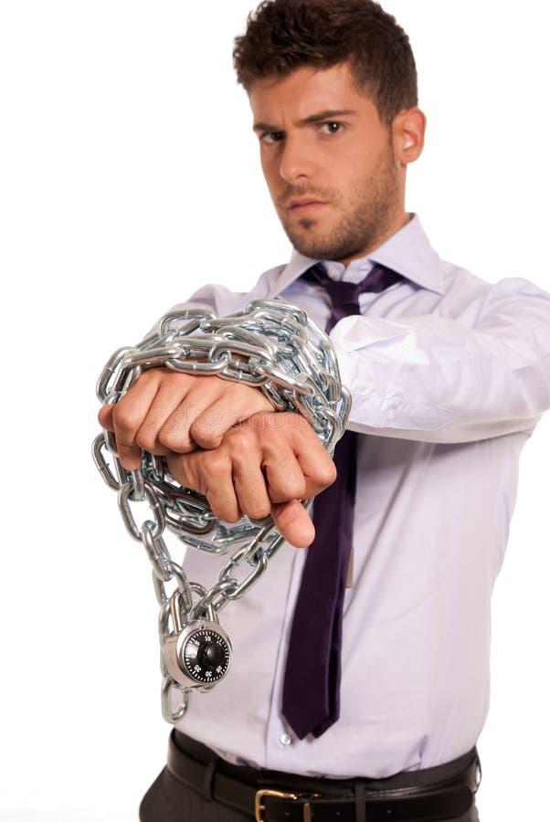 Homem de negócios acorrentado com cadeado, símbolo do escravo do trabalho fotos de stock
