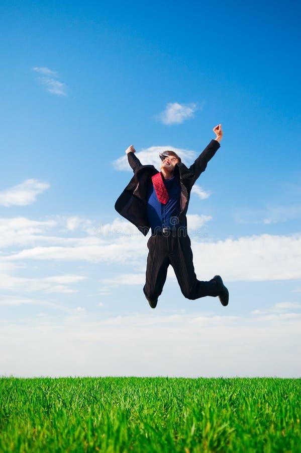 Homem de negócios afortunado no salto fotografia de stock royalty free