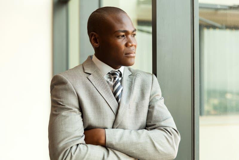 Homem de negócios africano pensativo fotografia de stock royalty free