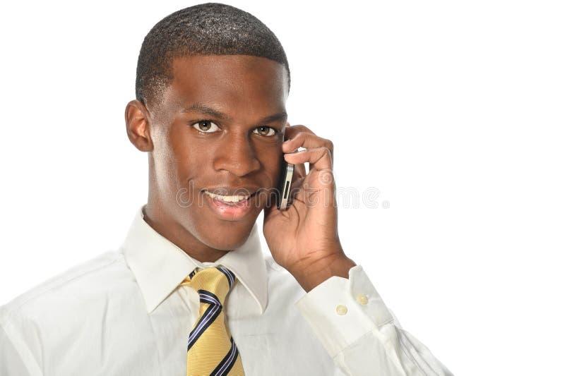 Homem de negócios afro-americano Using Cellphone imagens de stock royalty free