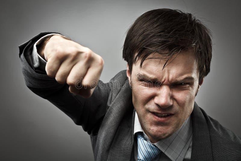 Homem de negócios agressivo imagens de stock