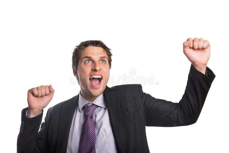 Homem de negócios alegre que cheering como olha acima imagem de stock