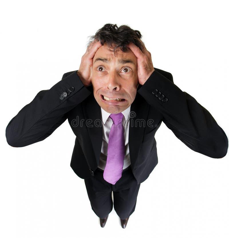 Homem de negócios ansioso que rasga no seu imagens de stock royalty free