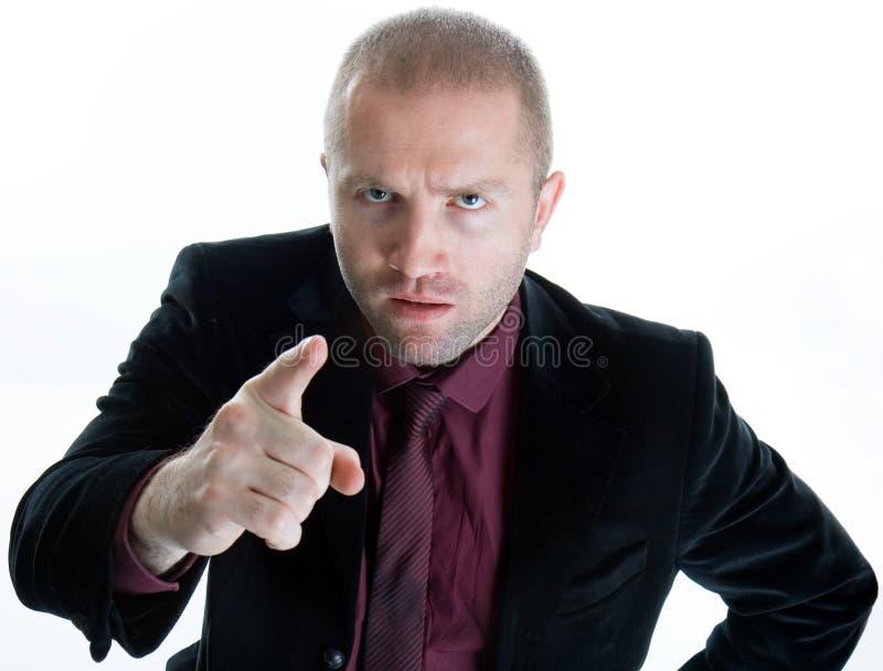 Homem de negócios apontando irritado imagens de stock