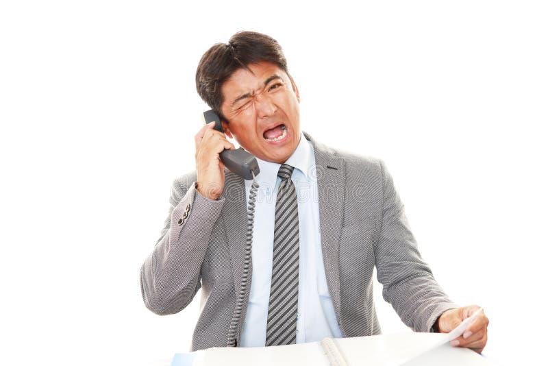 Homem de negócios asiático cansado fotos de stock royalty free