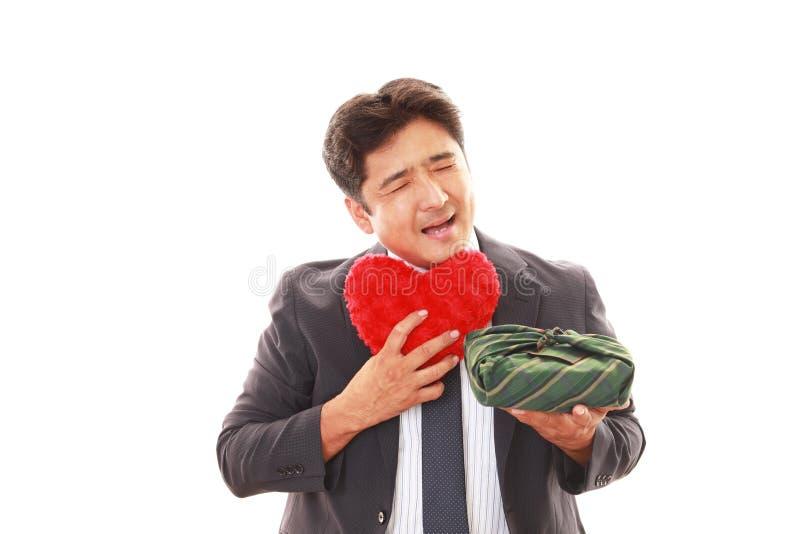 Homem de negócios asiático de sorriso fotografia de stock royalty free