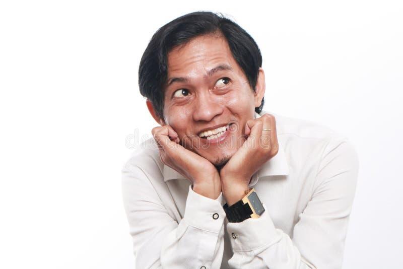 Homem de negócios asiático novo feliz Thinking imagens de stock royalty free
