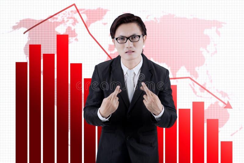 Homem de negócios asiático que deseja um sucesso da obtenção fotografia de stock