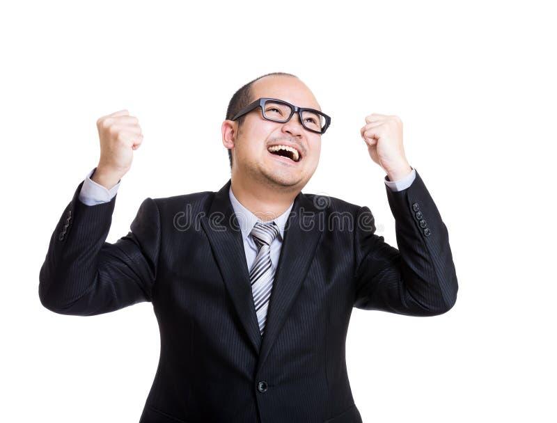 Homem de negócios asiático que sente entusiasmado imagens de stock