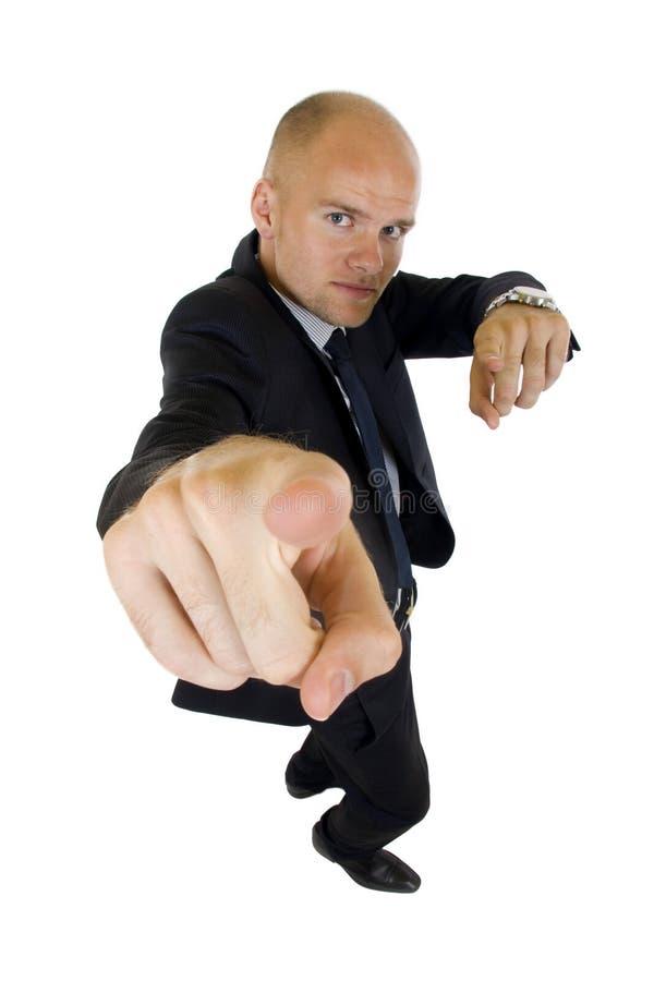 Homem de negócios assegurado que aponta em você foto de stock