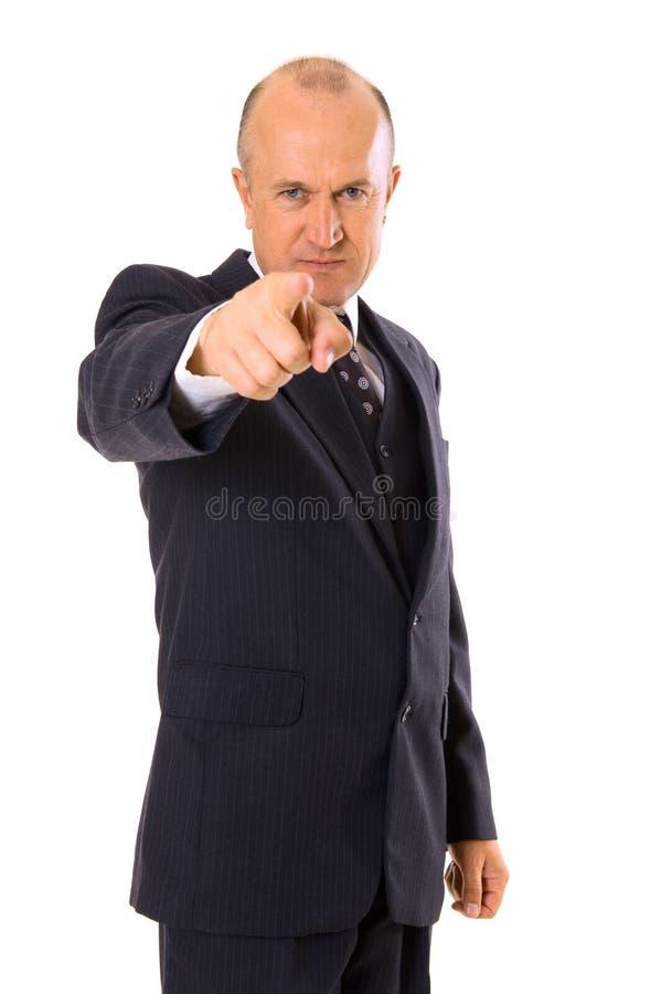 Homem de negócios assegurado que aponta em você fotografia de stock royalty free