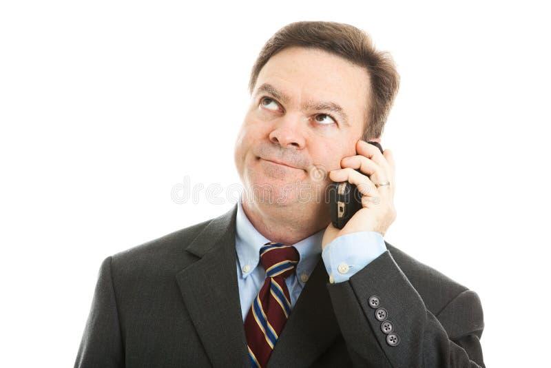 Homem de negócios - atendimento de telefone furando imagem de stock