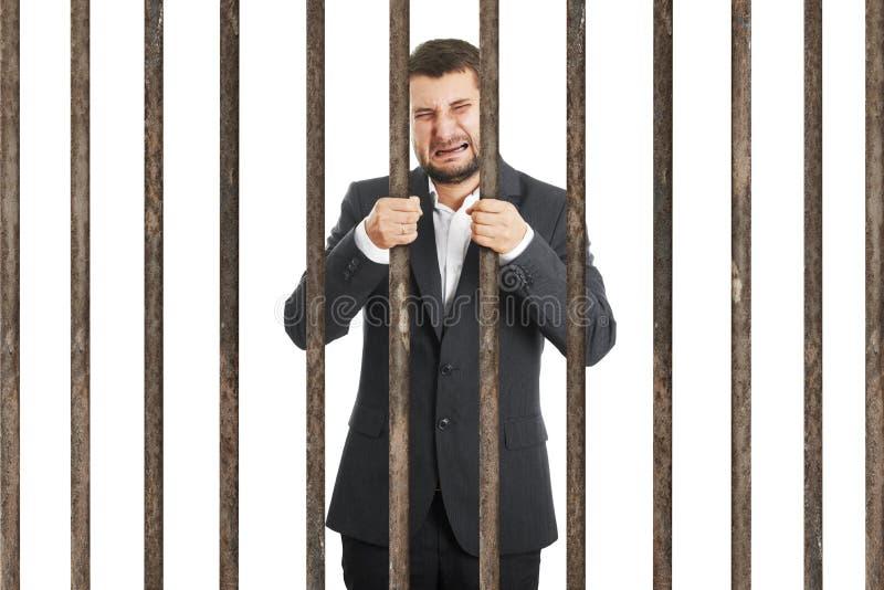 Homem de negócios atrás da cela imagens de stock