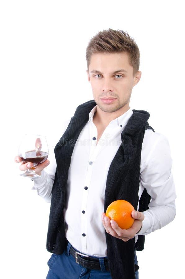 Homem de negócios atrativo novo com um vidro do vinho imagem de stock