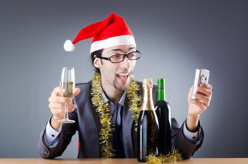 Homem de negócios bêbedo após a festa de Natal fotografia de stock royalty free