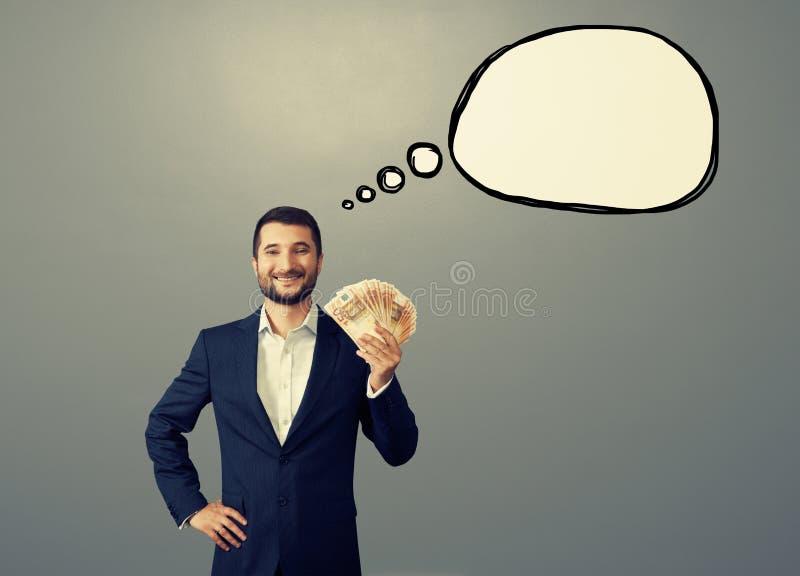 Homem de negócios bem sucedido com bolha do pensamento fotos de stock