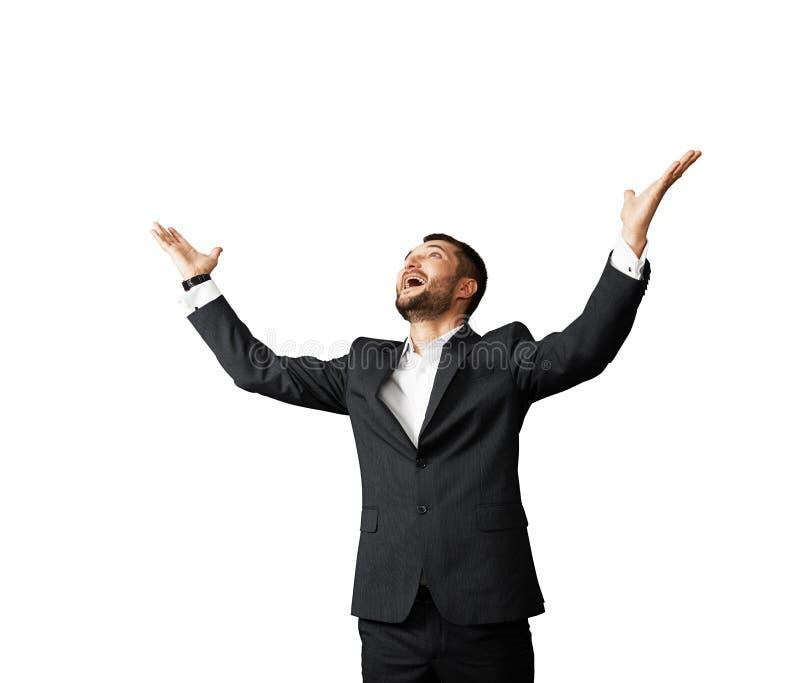 Homem de negócios bem sucedido que olha acima imagens de stock