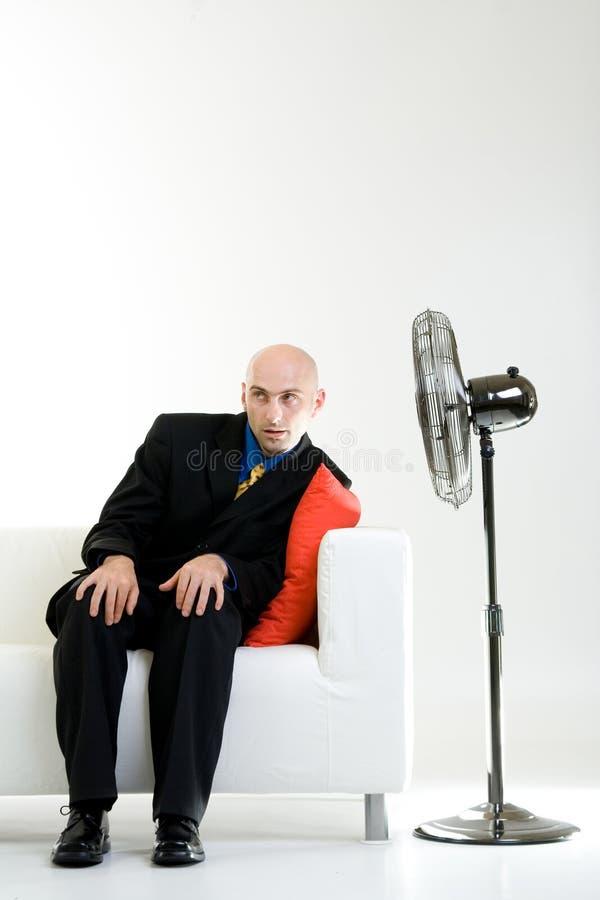 Homem de negócios calvo com ventilador imagens de stock