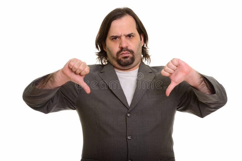 Homem de negócios caucasiano gordo que dá dois polegares para baixo imagens de stock