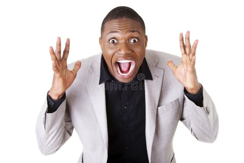 Homem de negócios chocado jovens foto de stock