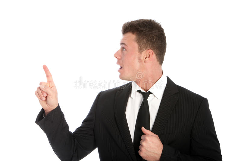 Homem de negócios chocado que aponta para cima imagem de stock royalty free