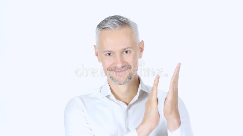Homem de negócios Clapping, aplaudindo no fundo branco foto de stock
