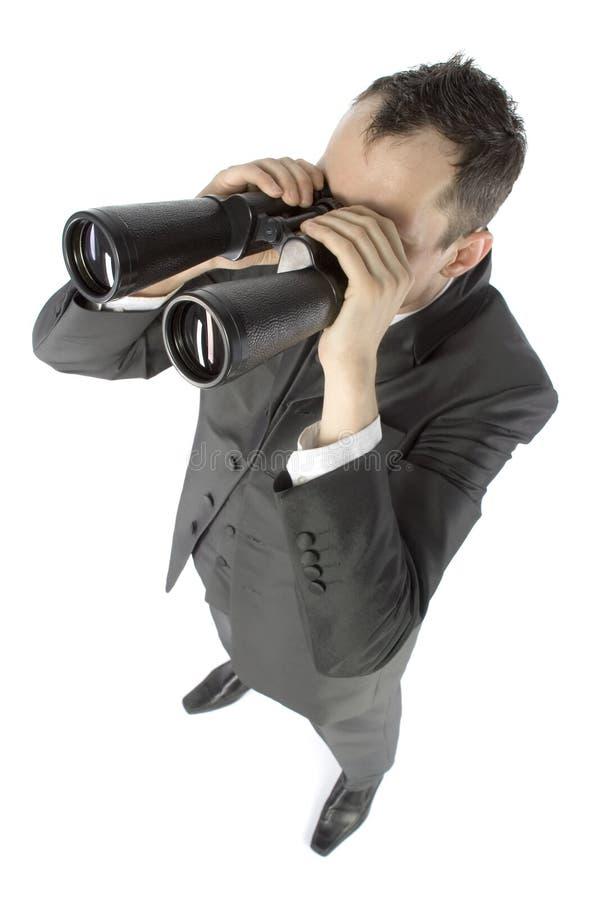 Homem de negócios com binóculos fotos de stock