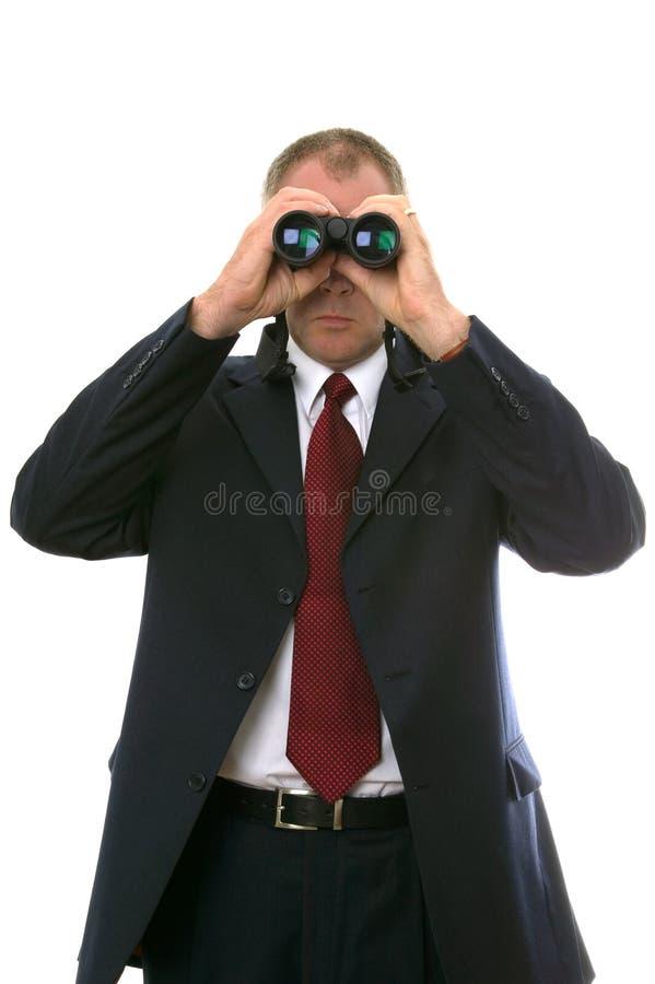 Homem de negócios com binóculos. fotos de stock royalty free