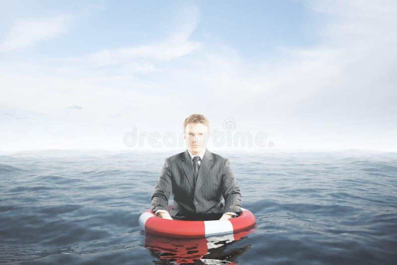 Homem de negócios com boia salva-vidas imagens de stock