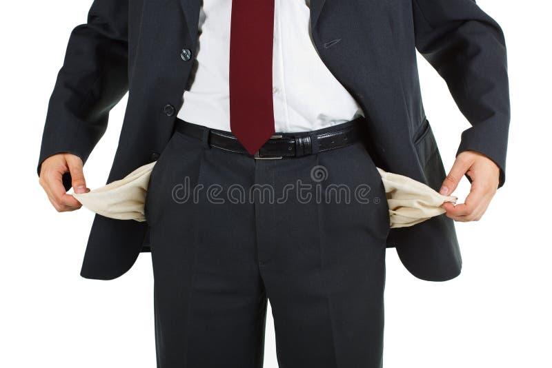 Homem de negócios com bolso vazio fotografia de stock royalty free