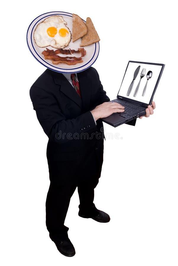 Homem de negócios com cabeça do pequeno almoço imagem de stock royalty free