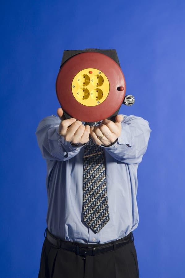 Homem de negócios com cabo elétrico imagens de stock